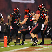08 September 2018: San Diego State Aztecs running back Juwan Washington (29) is congratulated by teammates after scoring a touchdown on a 14 yard run to give the Aztecs a 19-14 lead in the fourth quarter. The San Diego State Aztecs beat the Sacramento State Hornets 28-14 in their first home game of the season at SDCCU Stadium.