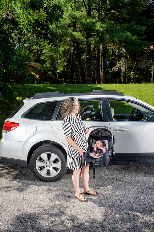 Pikesville, Maryland - June 25, 2015:  Car Seat Lady Alisa Baer, 35, from Manhattan, holds her 7 week-old niece Leora Aghion in a a Nuna Pipa infant car seat, ($300) at her sister's house in Pikesville, Maryland Thursday June 25th, 2015. <br /> Alisa's mother, Deborah Baer, was the original Car Seat Lady who, in the 1980's, started a car seat installation class in Maryland for new parents. Now in her 30's Alisa, and her childhood friend Emily Levine, also from Manhattan, expanded the Car Seat Lady business to New York. <br /> <br /> CREDIT: Matt Roth for The New York Times<br /> Assignment ID: 30176354A