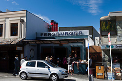 Patrons sit outside of Fergburger burger restaurant, Queenstown, South Island, New Zealand