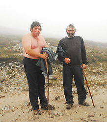 John Francis Lynn from Keenan Crossmolina and Paddy Gallagher from Drumconrath Co Meath on Croagh Patrick  on reek sunday...Pic Conor McKeown
