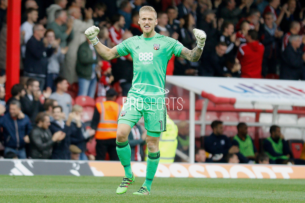 Brentford goalkeeper Daniel Bentley (1) celebrates a goal during the EFL Sky Bet Championship match between Brentford and Preston North End at Griffin Park, London, England on 17 September 2016. Photo by Andy Walter.