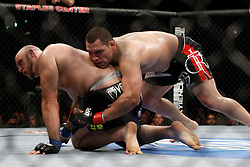 October 24, 2009; Los Angeles, CA; USA; Ben Rothwell (black/blue trunks) gets taken down by Cain Velasquez(black trunks) during their bout at UFC 104.  Velasquez won via 2nd round stoppage.  Mandatory Credit:  Ed Mulholland
