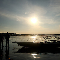People on the beach watching the currach racing as part of the Leon XIII festival in Quilty over the weekend<br />