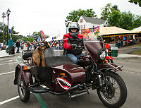 Russian made Ural three wheel motorcycle with sidecar and a sidekick heading down Lakeside Avenue Thursday afternoon.  (Karen Bobotas/for the Laconia Daily Sun)