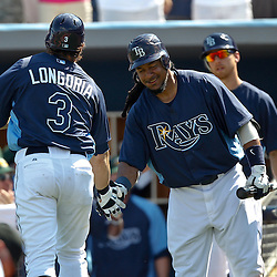 February 26, 2011; Port Charlotte, FL, USA; Tampa Bay Rays third baseman Evan Longoria (3) is congratulated by left fielder Manny Ramirez (24) after a homerun during a spring training exhibition game against the Pittsburgh Pirates at Charlotte Sports Park.  Mandatory Credit: Derick E. Hingle