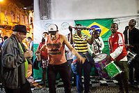 Musicians perform street samba under the arches in Lapa, the district known for nightlife, in Rio de Janeiro, Brazil, on Saturday, June 16, 2013.