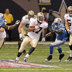 2009 September 13: New Orleans Saints wide receiver Robert Meachem (17) runs by Detroit Lions defenders Yamon Figurs (16) and Anthony Henry (32) on a kickoff return during a 45-27 win by the New Orleans Saints over the Detroit Lions at the Louisiana Superdome in New Orleans, Louisiana.