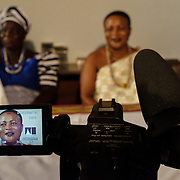 Nana Kofi Dzama, Chief of Asebu Ekrouful, giving an interview ahead of a swearing-in of new members of a council of Queen Mothers in Accra, Ghana on 23 June 2015. A queen mother is a traditional female leader, drawn from the relevant chiefly lineage, who is responsible for women's and children's issues in particular. Though often widely respected and sometimes powerful, especially in matrilineal ethnic groups, their authority is subject to a male chief. After being suppressed during the colonial era, the role of queen mother is being revived in Ghana and is seen by many as a force for development. It is notable that Nana Dzama is a woman chief, as opposed to a Queen Mother.