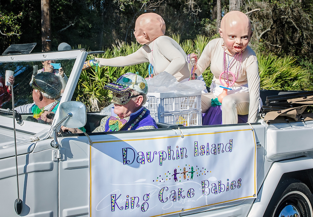 The King Cake Babies throw candy in the People's Parade during Mardi Gras in Dauphin Island, Alabama in Dauphin Island's first People's Parade during Mardi Gras, Feb. 4, 2017, in Dauphin Island, Alabama. French settlers held the first Mardi Gras in 1703, making Mobile's celebration the oldest Mardi Gras in the United States. The first parade of the season is traditionally held on Dauphin Island and draws thousands. (Photo by Carmen K. Sisson/Cloudybright)