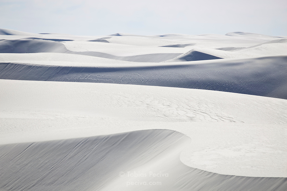 Layers of white sand dunes in White Sands National Monument, New Mexico.