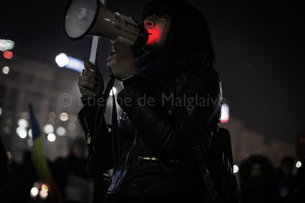 A protester, Denisa, 24, shouts slogan trough a bull horn as hundreds gathered every evening in front of the government headquarters at the Victory square are now demanding resignation of PM Sorin Grindeanu.  15 February 2017.