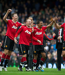 BLACKBURN, ENGLAND - Saturday, May 14, 2011: Manchester United's Michael Carrick, Wayne Rooney, Rio Ferdinand celebrate winning the FA Premier League after his side scrapped a 1-1 draw with Blackburn Rovers during the Premiership match at Ewood Park. (Photo by David Rawcliffe/Propaganda)