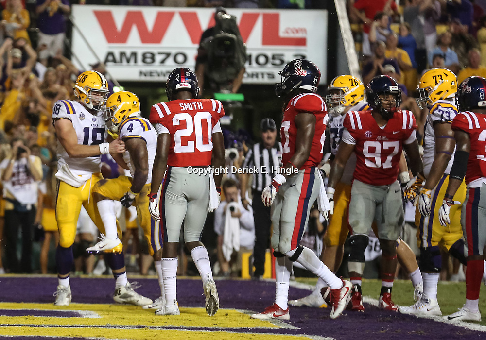 Sep 29, 2018; Baton Rouge, LA, USA; LSU Tigers running back Nick Brossette (4) celebrates with tight end Foster Moreau (18) after a touchdown against the Mississippi Rebels during the first quarter of a game at Tiger Stadium. Mandatory Credit: Derick E. Hingle-USA TODAY Sports
