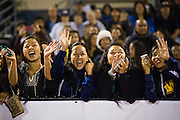 Spectators cheer for Homecoming Queen contestants during the Homecoming halftime festivities against Saratoga at Milpitas High School in Milpitas, California, on October 10, 2014. Milpitas beat Saratoga 49-0. (Stan Olszewski/SOSKIphoto)