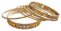 Gold bangle bracelets on white background