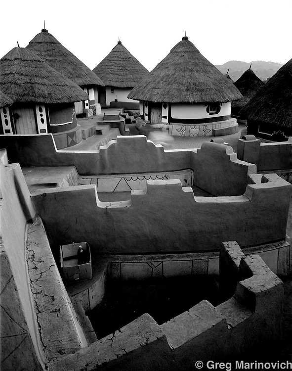 IPMG0379 South Africa, Shongwezi, 1989: The intricate maze of walls demarcates each family's courtyard in the sacred village of Shongwezi in the mountains above Louis Trichardt, Limpopo Province South Africa, July 1989. The Mphephu royalty are buried in a sacred grove here, and the village exists to protect and serve the spirits of the ancestors..Photograph by Greg Marinovich/South Photographs