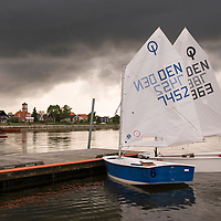 Dark storm clouds approach Dragor, an old fishing town located 12km from Copenhagen, Denmark.
