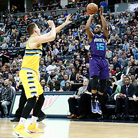 04 March 2017: Charlotte Hornets guard Kemba Walker (15) takes a jump shot over Denver Nuggets forward Nikola Jokic (15) during the Charlotte Hornets 112-102 victory over the Denver Nuggets, at the Pepsi Center, Denver, Colorado, USA.