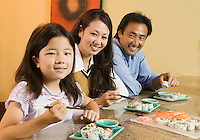 Family Eating Sushi Together