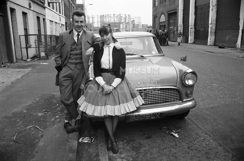 Boy and Girl by a Car,London. UK, 1980s.