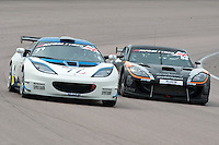 #77 Osman Yusuf/Gavan Kershaw - ISSY Racing, Lotus Evora GT4 and #55 Oli Basey-Fisher/Matt Nicoll-Jones - Academy Motorsport, Ginetta G55 GT4 during British GT Championship race at Rockingham, Corby, Northamptonshire, United Kingdom. May 05 2014. World Copyright Peter Taylor/PSP. Copy of publication required for printed pictures.  Every used picture is fee-liable. http://archive.petertaylor-photographic.co.uk