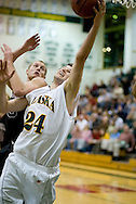 1/6/2006: Sophomore forward Ivan Platenik (24) of the UAA Seawolves grabs a rebound as Anchorage goes on to beat the visiting Central Washington Wildcats, 80-60 at the Wells Fargo Sports Complex on the campus of UAA.<br />