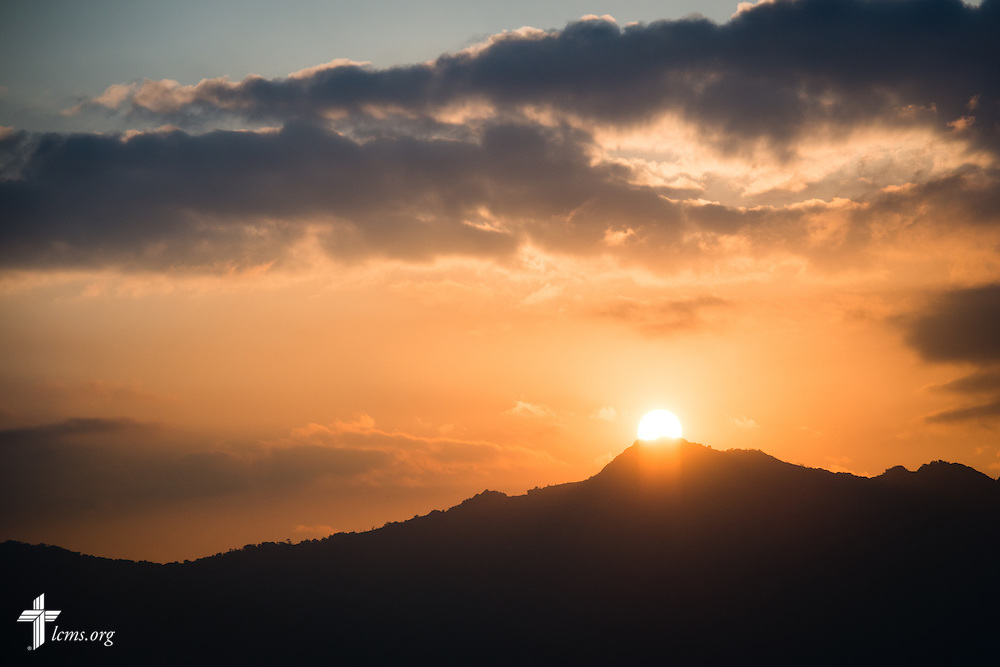 The sun rises over highland mountain passes on Sunday, Sept. 27, 2015, in southern Malawi. LCMS Communications/Erik M. Lunsford