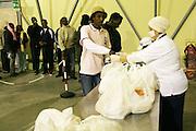 Bari 12 01 2010 foto di Donato Fasano : CARA (Centro accoglienza richiedenti asilo) i trasferiti di Rosarno, mensa