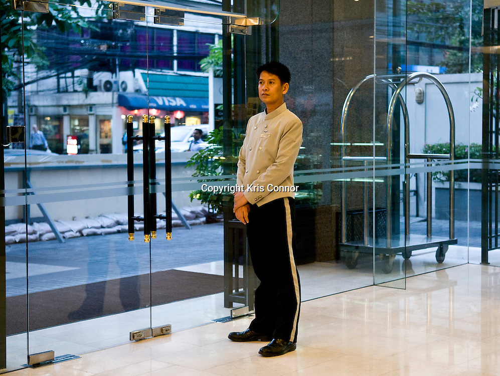 A doorman at the Chesapeake House hotel in Bangkok, Thailand. Photo by Kris Connor