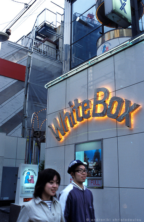 LOVE HOTEL HILL-SHIBUYA. Young couple passing in front of Love Hotel WHITE BOX
