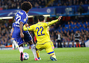 Willian keeps the ball from Avi Rikan during the Champions League match between Chelsea and Maccabi Tel Aviv at Stamford Bridge, London, England on 16 September 2015. Photo by Andy Walter.