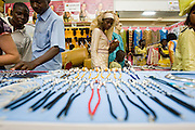 Customers walk past a jewelry booth at the 22nd Salon International de l'Artisanat de Ouagadougou (SIAO) in Ouagadougou, Burkina Faso on Friday October 31, 2008.