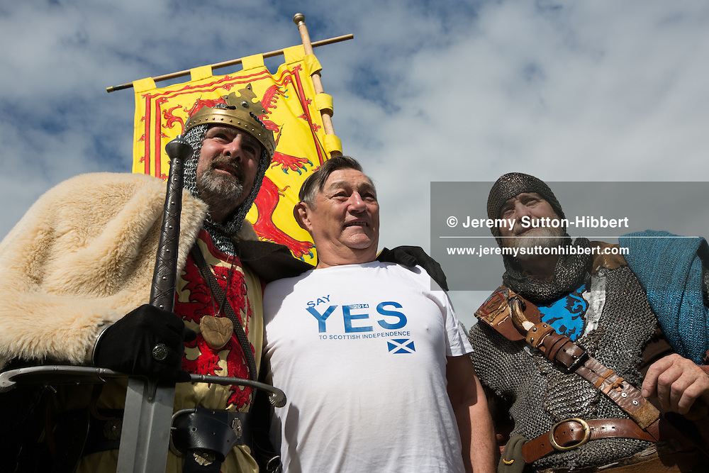 'Robert The Bruce' (left) with Pro-Independence 'Yes Scotland' supporter at Bannockburn Live festivities, commemorating the 700 year anniversary of the Battle Of Bannockburn in which King Robert the Bruce and the Scots army defeated the English army under King Edward II, Bannockburn near Stirling, Scotland, Sunday 29th June 2014.
