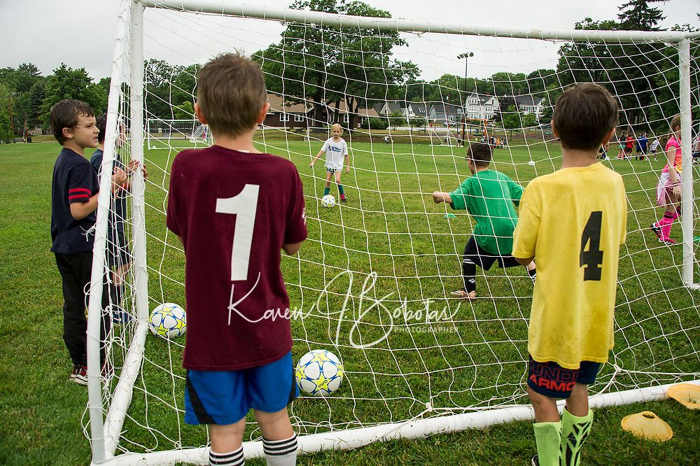 Team mates in Division III work  together on drills with On Goal Soccer Camp at Leavitt Park Thursday morning.  (Karen Bobotas/for the Laconia Daily Sun)