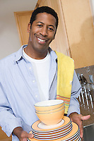 Man with stack of dishes