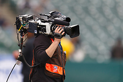 Dec 18, 2011; Oakland, CA, USA; A cameraman with video equipment on the field before the game between the Oakland Raiders and the Detroit Lions at O.co Coliseum. Detroit defeated Oakland 28-27. Mandatory Credit: Jason O. Watson-US PRESSWIRE