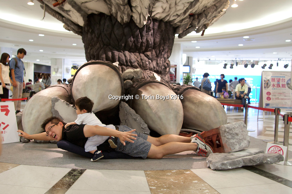 "July 23, Tokyo, Japan: This huge Godzilla foot is temporarily on display at Sunshine City, a shopping mall popular for it's complex of micro theme parks, and shops and restaurants dedicated to Japanese manga, animation, movie and teen pop culture. The attraction which appears as if Godzilla stomped his foot through the ceiling is promoting the release of the latest Godzilla film by Toho Co. Ltd. entitled ""Godzilla Resurgence"" (Japanese title ""Shin Godzilla""). This was released nationwide in Japan on July, 29, 2016 and is the 29th film in Toho's Godzilla franchise. Their first Godzilla film was released in 1954 and is now considered a sci-fi cult classic. (Torin Boyd/Polaris)."