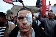 Wounded from previous days clashes, a protester wears a bandage covering his eye on Tahrir Square during a demonstration prior to first election since Mubarak departure.  November 27, 2011 in Cairo, Egypt.  © Etiennne de Malglaive.