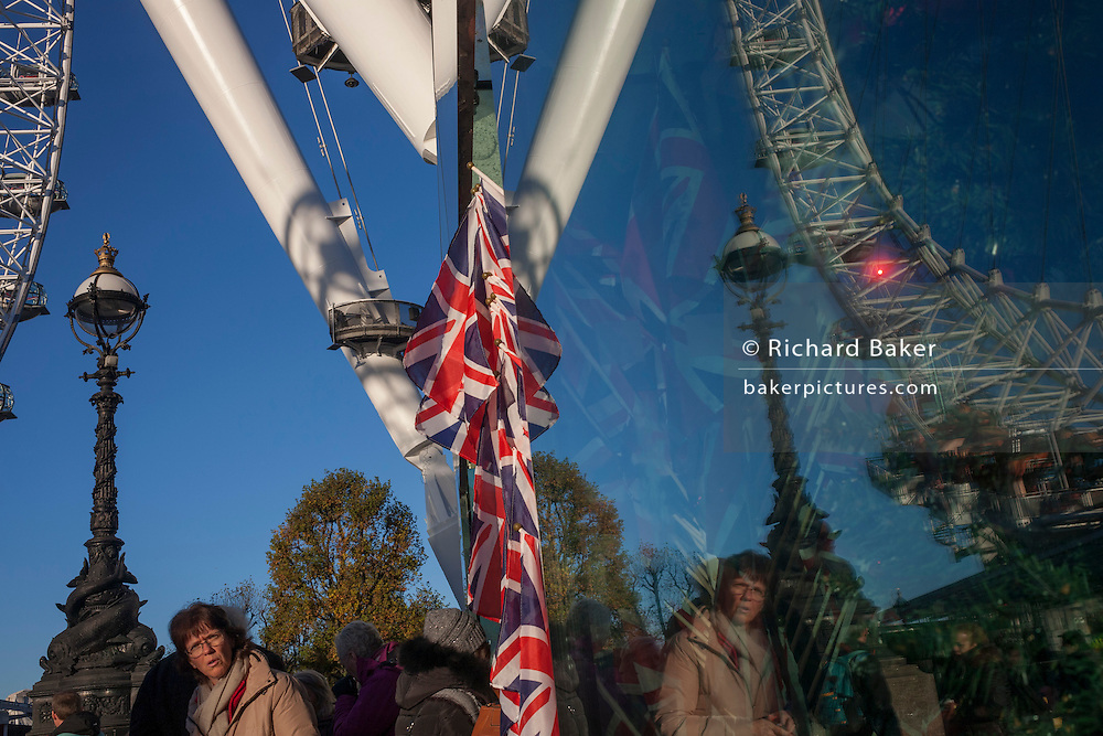 British union jack flags with the curve of the London Eye ferris wheel, on 29th November 2016, on the Southbank in London, England.