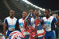Great Britain Gold Medalists celebrate. Jason Gardener,Marlon Devonish,Darren Campell and Mark Lewis Francis.Mens 4 X 100 Relay Final.28/8/2004.Athens Olympics 2004. Credit : Colorsport/Andrew Cowie.