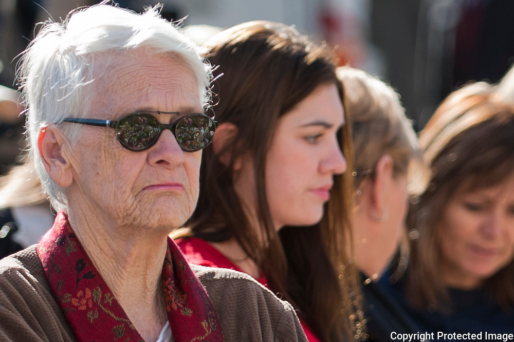 The memorial is reflected in the sunglasses of one of the visitors. Located at the memorial in front of the University of Arizona Medical Center in Tucson, Arizona. The memorial was placed for the victims of the recent shooting in Tucson.