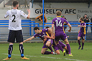 Dan Holman scores and celebrates his goal during the Vanarama National League match between Guiseley  and Cheltenham Town at Nethermoor Park, Guiseley, United Kingdom on 9 April 2016. Photo by Antony Thompson.