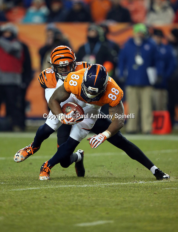 Denver Broncos wide receiver Demaryius Thomas (88) gets tackled by Cincinnati Bengals cornerback Josh Shaw (26) after catching a third quarter pass for a gain of 7 yards during the 2015 NFL week 16 regular season football game against the Cincinnati Bengals on Monday, Dec. 28, 2015 in Denver. The Broncos won the game in overtime 20-17. (©Paul Anthony Spinelli)