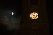 Goshenl, New York - Total lunar eclipse through the clouds by the steeple of the First Presbyterian Church  on Sept. 27, 2015.