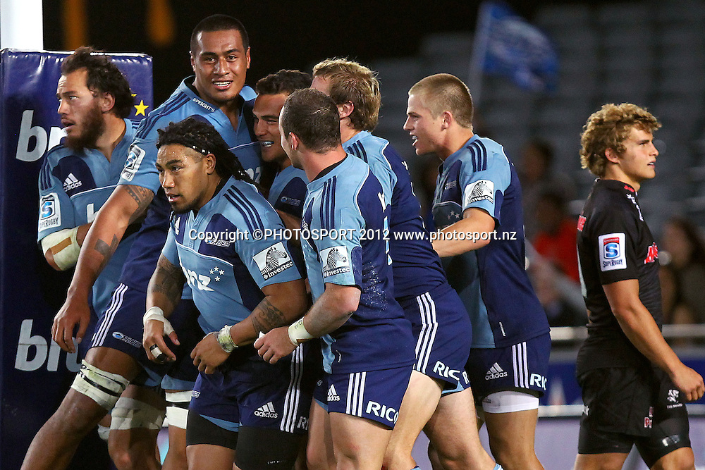 Blues players celebrate Benson Stanley's try. Super Rugby rugby union match, Blues v Sharks at Eden Park, Auckland, New Zealand. Friday 13th April 2012. Photo: Anthony Au-Yeung / photosport.co.nz