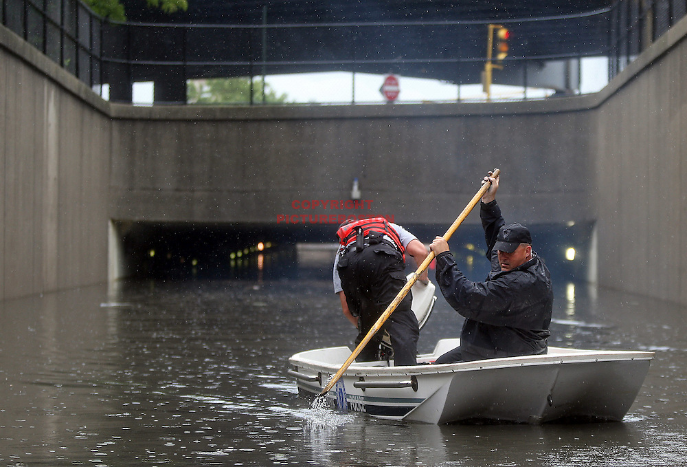 (07/10/10-Somerville,MA) The Massachusetts state police marine unit searches under the Mystic Ave underpass for any signs of life in several cars that were fully submerged after a flash flood late this afternoon.Boston Herald Staff photo by Mark Garfinkel