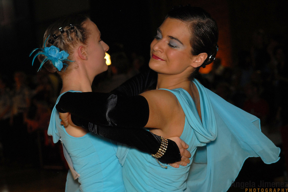 Cornelia Wagner, right, and Ulrike Storch, both of Germany, compete in the adult women's standard division of the same-sex ballroom dancing competition during the 2007 Eurogames at the Waagnatie hangar in Antwerp, Belgium on July 13, 2007. ..Over 3,000 LGBT athletes competed in 11 sports, including same-sex dance, during the 11th annual European gay sporting event. Same-sex ballroom is a growing sports that has been happening in Europe for over two decades.