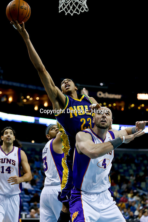 Feb 6, 2013; New Orleans, LA, USA; New Orleans Hornets power forward Anthony Davis (23) shoots over Phoenix Suns center Marcin Gortat (4) during  the first quarter of a game at the New Orleans Arena. Mandatory Credit: Derick E. Hingle-USA TODAY Sports