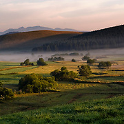 Early morning sunset with mist with view on the Sancy. Auvernge, France