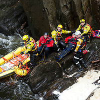 Tayside Fire & Rescue Water Rescue Exercise, The Hermitage, Dunkeld, Perthshire...04.05.10<br /> Record reporter James Moncur in the raging waters of the River Braan at The Hermitage with Mike Assenti from Tayside Police Search & Rescue, Mike was acting as the casualty preparing to load him onto the Rescue Sled<br /> Picture by Graeme Hart.<br /> Copyright Perthshire Picture Agency<br /> Tel: 01738 623350  Mobile: 07990 594431